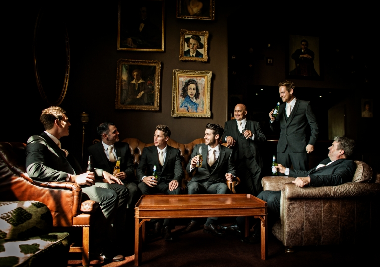 Natural reportage photography of Groom and Groomsmen in bar at Stubton Hall wedding